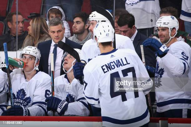 Pierre Engvall of the Toronto Maple Leafs is congratulated by head coach Sheldon Keefe after scoring a short handed goal against the Arizona Coyotes...
