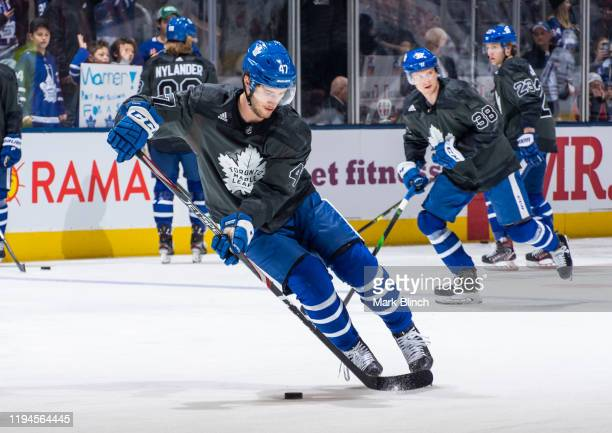 Pierre Engvall of the Toronto Maple Leafs wears a jersey honouring the Canadian Armed Forces during warmup before facing the Chicago Blackhawks at...