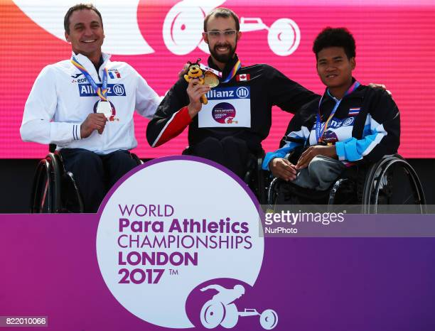 LR Pierre Fairbank of France Silver Medal Brent Lakatos of Canada Gold Medal Pongsakorn Paeyo of Thailand receive his Bronze medal Men's 800m T53...