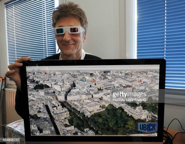 Pierre Farout cofounder of the Imao cartography company presents the 3D Ubick system on December 10 2013 in Limoges AFP PHOTO / PASCAL LACHENAUD