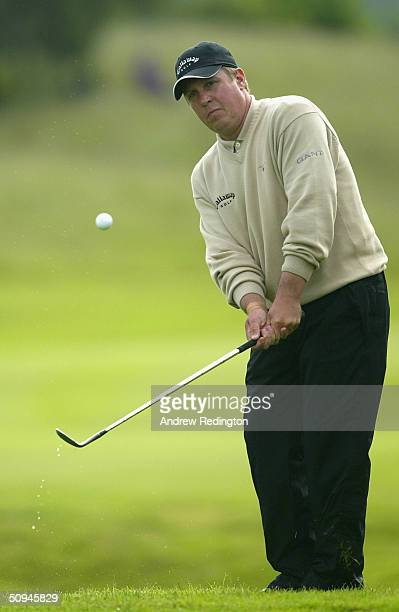 Pierre Fulke of Sweden plays a chip shot on the 12th hole during the first round of the Diageo Championship at Gleneagles on June 10 2004 in...
