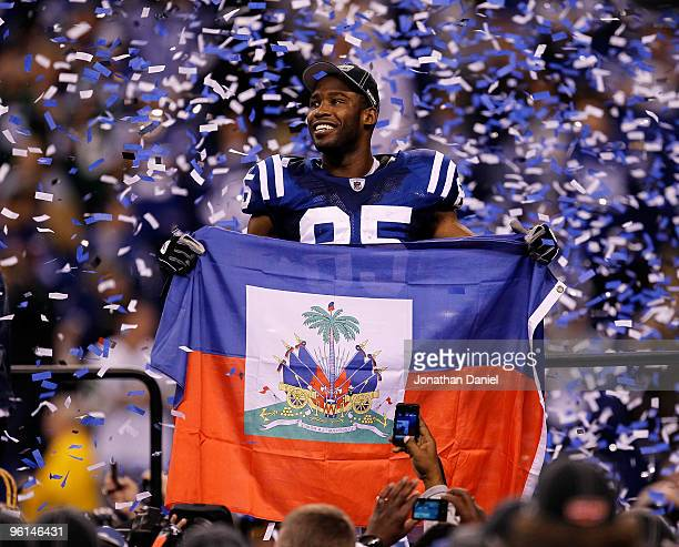 Pierre Garcon of the Indianapolis Colts holds up a Haitian flag during the Lamar Hunt Trophy presentation after defeating the New York Jets 3017...
