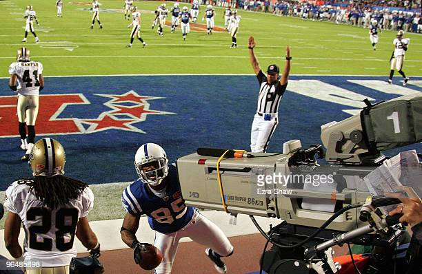 Pierre Garcon of the Indianapolis Colts runs into a TV camera making a catch for a touchdown in the first quarter against the New Orleans Saints...