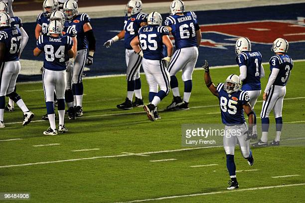 Pierre Garcon of the Indianapolis Colts runs off the field after making a catch for a touchdown against the New Orleans Saints during the first...