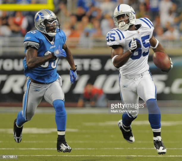 Pierre Garcon of the Indianapolis Colts runs with the football past LaMarcus Hicks of the Detroit Lions during the game at Ford Field on August 29,...