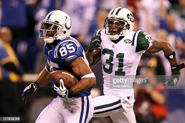 Pierre Garcon of the Indianapolis Colts scores on a 57yard touchdown reception in the seocnd quarter against Antonio Cromartie of the New York Jets...