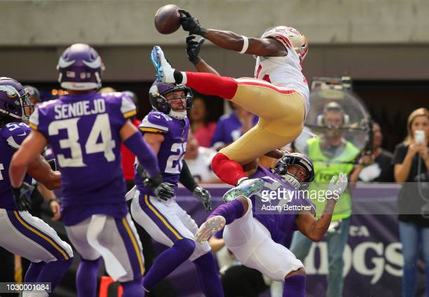 Pierre Garcon of the San Francisco 49ers attempts to catch the ball over defender Mike Hughes of the Minnesota Vikings in the second half of the game...