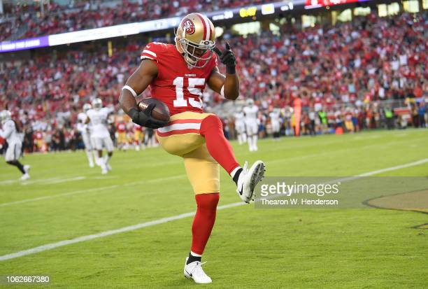 Pierre Garcon of the San Francisco 49ers celebrates after scoring a touchdown against the Oakland Raiders during the first half of their NFL football...