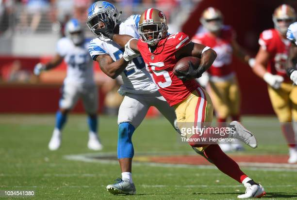 Pierre Garcon of the San Francisco 49ers fights off the tackle of Quandre Diggs of the Detroit Lions during the fourth quarter of an NFL football...