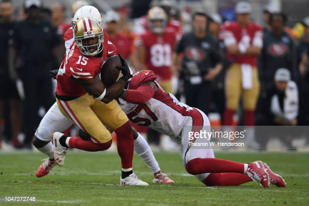 Pierre Garcon of the San Francisco 49ers runs after a catch against the Arizona Cardinals during their NFL game at Levi's Stadium on October 7 2018...