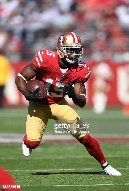 Pierre Garcon of the San Francisco 49ers runs with the ball after catching a pass against the Dallas Cowboys during their NFL football game at Levi's...