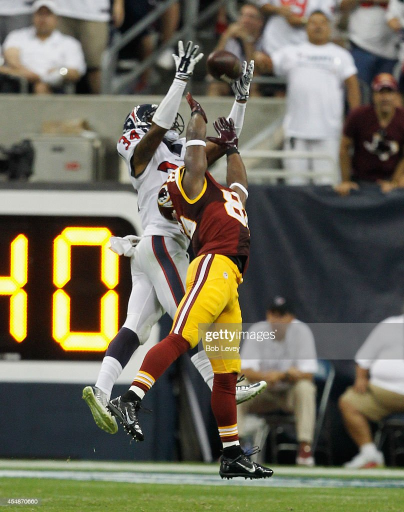 Pierre Garcon #88 of the Washington Redskins and A.J. Bouye #34 of the Houston Texans battle for the ball at Reliant Stadium on September 7, 2014 in Houston, Texas.