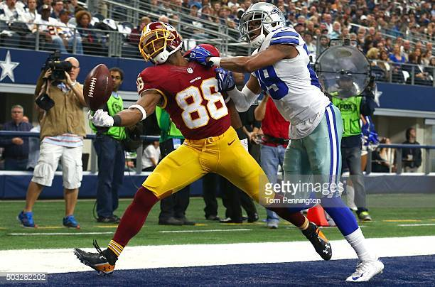 Pierre Garcon of the Washington Redskins attempts to make a touchdown catch against Deji Olatoye of the Dallas Cowboys during the first half at ATT...