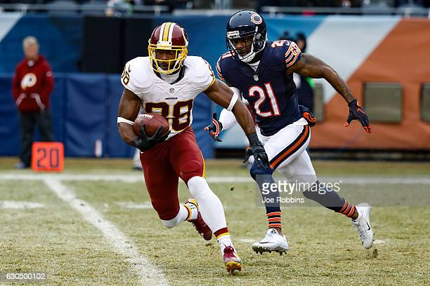Pierre Garcon of the Washington Redskins carries the football against Tracy Porter of the Chicago Bears in the second quarter at Soldier Field on...