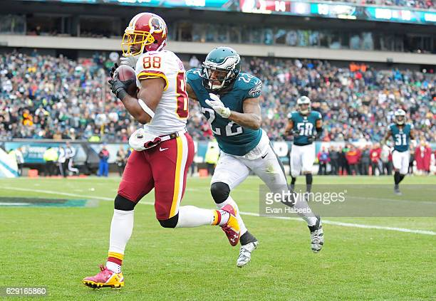 Pierre Garcon of the Washington Redskins catches a touchdown in front of Nolan Carroll of the Philadelphia Eagles in the third quarter at Lincoln...