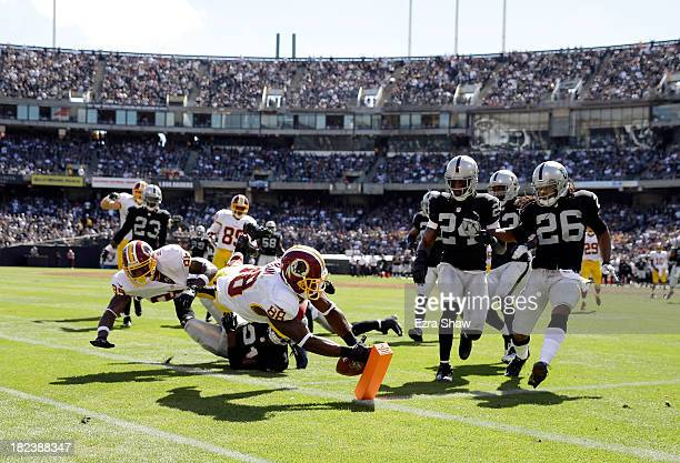Pierre Garcon of the Washington Redskins dives for the endzone against the Oakland Raiders at Oco Coliseum on September 29 2013 in Oakland California...