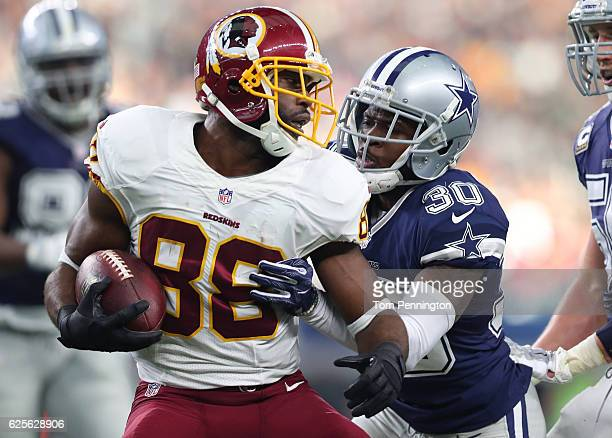Pierre Garcon of the Washington Redskins is tackled by Anthony Brown of the Dallas Cowboys after catching a pass in their game at ATT Stadium on...