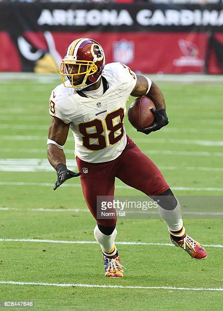 Pierre Garcon of the Washington Redskins runs with the ball against the Arizona Cardinals at University of Phoenix Stadium on December 4 2016 in...