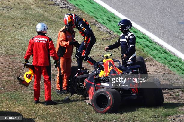 Pierre Gasly of France and Red Bull Racing climbs from his car after crashing during practice for the F1 Grand Prix of Germany at Hockenheimring on...