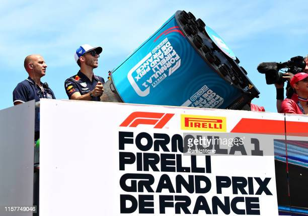 Pierre Gasly of France and Red Bull Racing fires tshirts to fans on the drivers parade before the F1 Grand Prix of France at Circuit Paul Ricard on...