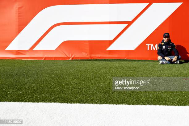 Pierre Gasly of France and Red Bull Racing poses for a photo with the F1 logo during previews ahead of the F1 Grand Prix of Spain at Circuit de...