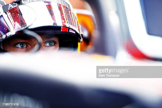 Pierre Gasly of France and Red Bull Racing prepares to drive in the garage during practice for the F1 Grand Prix of Hungary at Hungaroring on August...