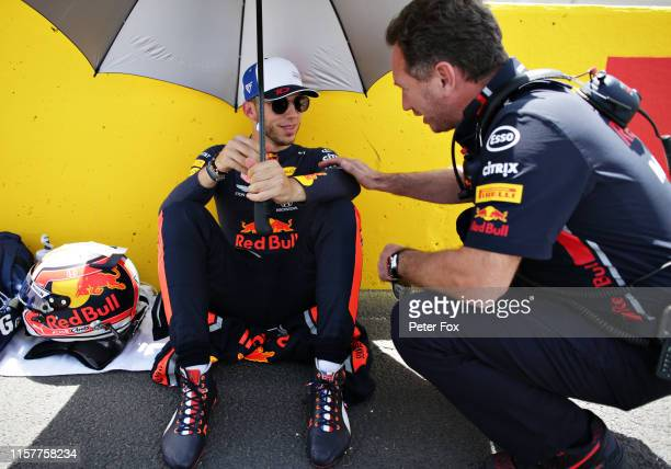 Pierre Gasly of France and Red Bull Racing talks with Red Bull Racing Team Principal Christian Horner on the grid before the F1 Grand Prix of France...