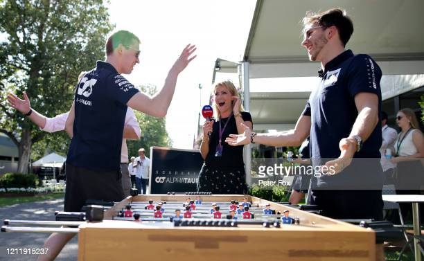 Pierre Gasly of France and Scuderia AlphaTauri and Daniil Kvyat of Russia and Scuderia AlphaTauri play table football in the Paddock during previews...