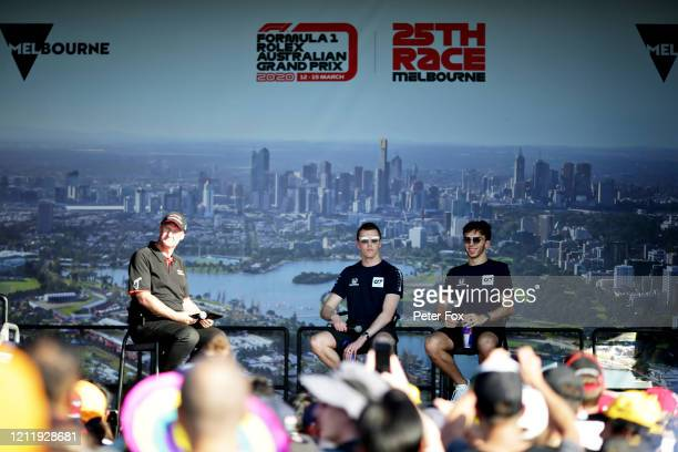 Pierre Gasly of France and Scuderia AlphaTauri and Daniil Kvyat of Russia and Scuderia AlphaTauri talk on the fan stage during previews ahead of the...
