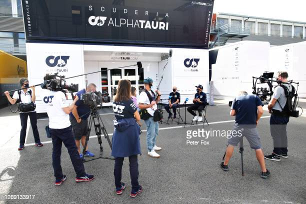 Pierre Gasly of France and Scuderia AlphaTauri and Scuderia AlphaTauri Team Principal Franz Tost talk to the media in the Paddock during previews...