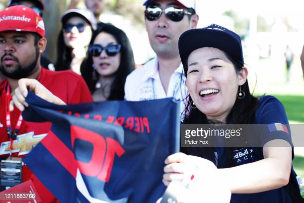 Pierre Gasly of France and Scuderia AlphaTauri fan shows their support outside the paddock during previews ahead of the F1 Grand Prix of Australia at...