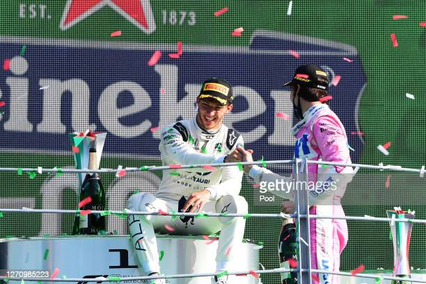 Pierre Gasly of France and Scuderia AlphaTauri is congratulated by Lance Stroll of Canada and Racing Point following the F1 Grand Prix of Italy at...