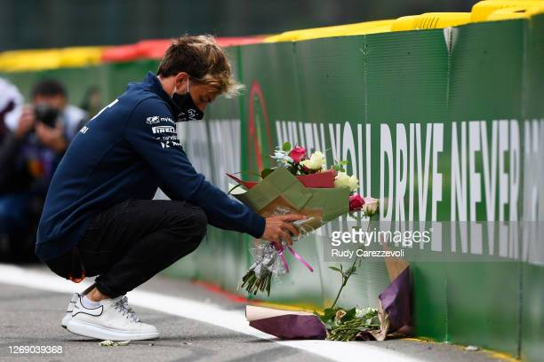 Pierre Gasly of France and Scuderia AlphaTauri leaves flowers at the side of the track in tribute to the late Formula 2 driver Anthoine Hubert, who...