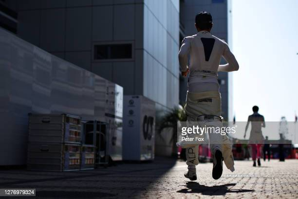 Pierre Gasly of France and Scuderia AlphaTauri runs in the Paddock prior to the F1 Grand Prix of Russia at Sochi Autodrom on September 27 2020 in...