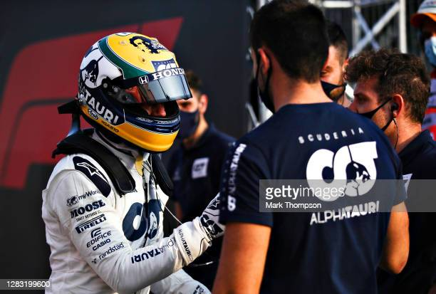 Pierre Gasly of France and Scuderia AlphaTauri shakes hands with a Scuderia AlphaTauri team member after qualifying ahead of the F1 Grand Prix of...