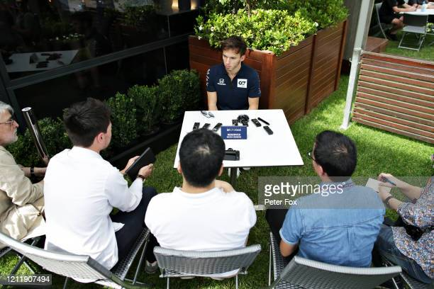 Pierre Gasly of France and Scuderia AlphaTauri talks to the media in the Paddock during previews ahead of the F1 Grand Prix of Australia at Melbourne...