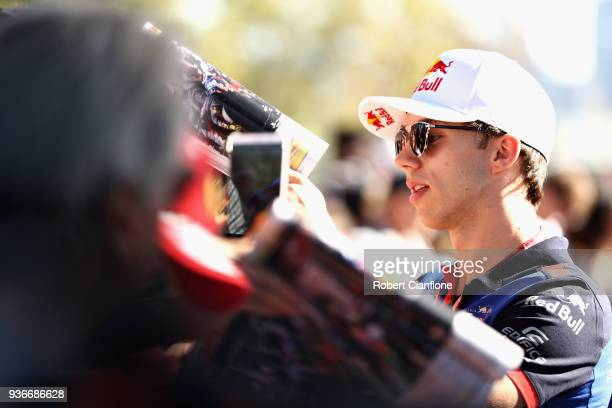 Pierre Gasly of France and Scuderia Toro Rosso arrives at the circuit and signs autographs for fans before practice for the Australian Formula One...
