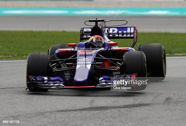 Pierre Gasly of France and Scuderia Toro Rosso drives in the Scuderia Toro Rosso STR12 on track during the Malaysia Formula One Grand Prix at Sepang...