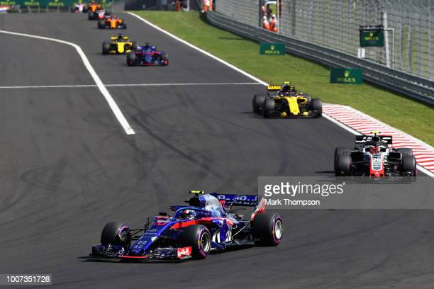 Pierre Gasly of France and Scuderia Toro Rosso driving the Scuderia Toro Rosso STR13 Honda leads Kevin Magnussen of Denmark driving the Haas F1 Team...