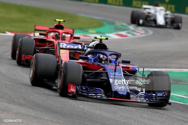 Pierre Gasly of France and Scuderia Toro Rosso driving the Scuderia Toro Rosso STR13 Honda leads Kimi Raikkonen of Finland driving the Scuderia...