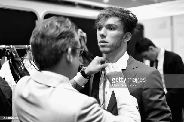 Pierre Gasly of France and Scuderia Toro Rosso prepares backstage at the Amber Lounge Fashion show during previews ahead of the Monaco Formula One...
