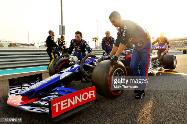 Pierre Gasly of France and Scuderia Toro Rosso prepares to drive on the grid before the F1 Grand Prix of Abu Dhabi at Yas Marina Circuit on December...