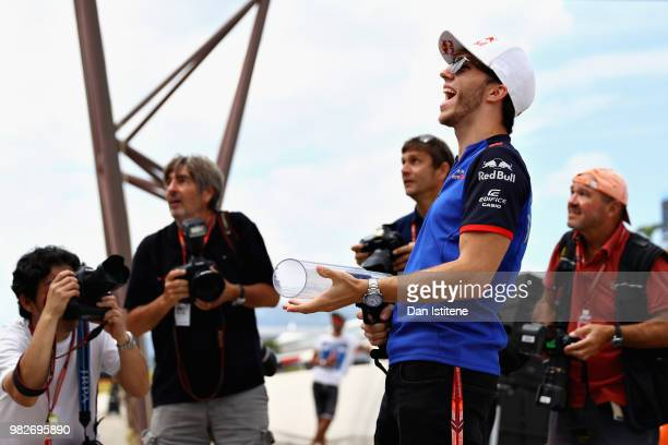 Pierre Gasly of France and Scuderia Toro Rosso shoots tshirts into the crowd before the Formula One Grand Prix of France at Circuit Paul Ricard on...