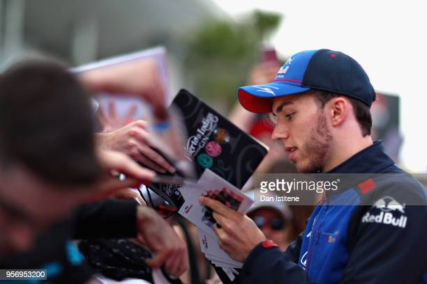 Pierre Gasly of France and Scuderia Toro Rosso signs autographs for fans during previews ahead of the Spanish Formula One Grand Prix at Circuit de...