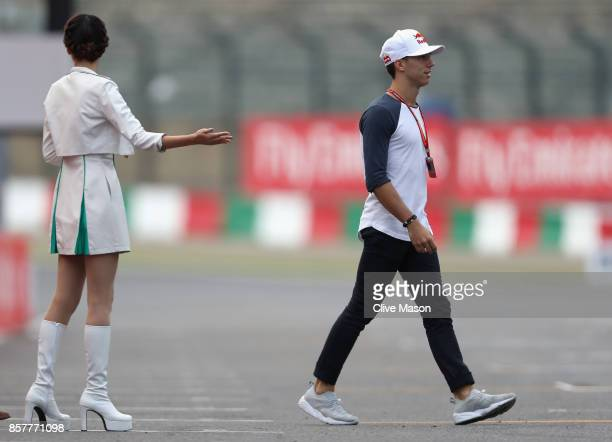 Pierre Gasly of France and Scuderia Toro Rosso walks on track during previews ahead of the Formula One Grand Prix of Japan at Suzuka Circuit on...