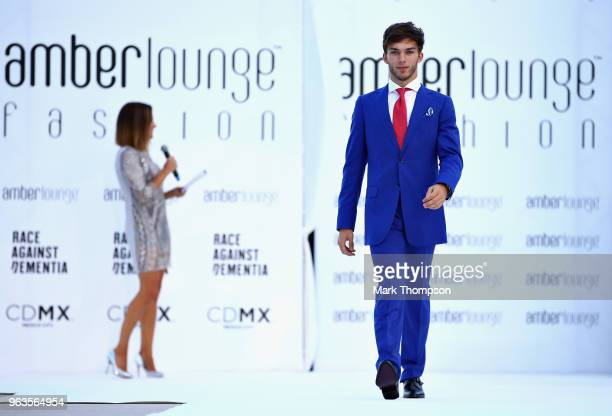 Pierre Gasly of France and Scuderia Toro Rosso walks the catwalk at the Amber Lounge Fashion show during previews ahead of the Monaco Formula One...