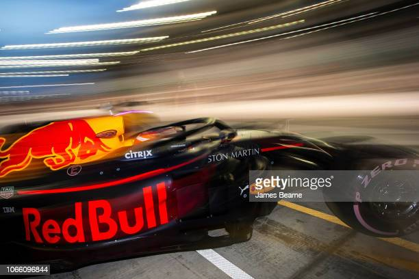 Pierre Gasly of France driving the Aston Martin Red Bull Racing RB14 TAG Heuer leaves the garage during day two of F1 End of Season Testing at Yas...