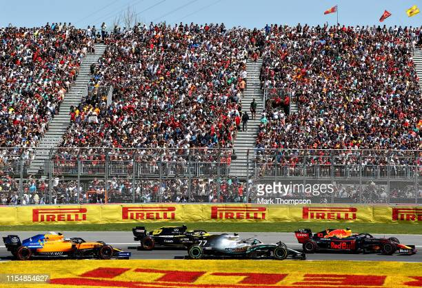 Pierre Gasly of France driving the Aston Martin Red Bull Racing RB15 leads Valtteri Bottas driving the Mercedes AMG Petronas F1 Team Mercedes W10,...