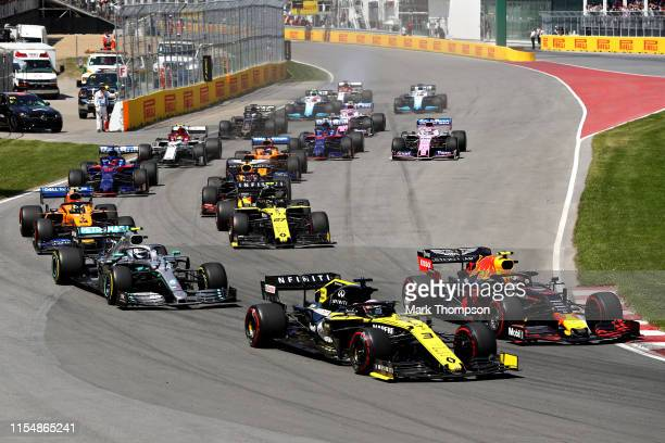 Pierre Gasly of France driving the Aston Martin Red Bull Racing RB15 battles with Daniel Ricciardo of Australia driving the Renault Sport Formula One...