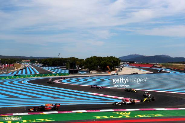 Pierre Gasly of France driving the Aston Martin Red Bull Racing RB15 leads Antonio Giovinazzi of Italy driving the Alfa Romeo Racing C38 Ferrari and...